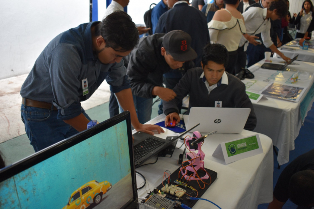 Participants were performing their works of the robot arm.png